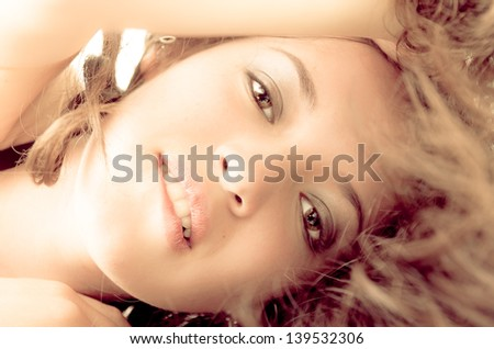 Attractive brunette woman biting her lips color processed - stock photo