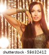 Attractive brunette woman in the night club - stock photo
