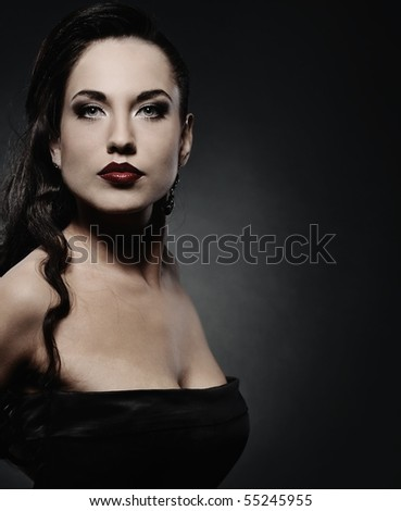 Attractive brunette woman isolated on grey background
