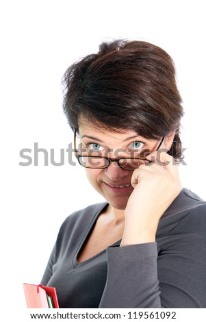 Attractive brunette woman peering over her glasses as she lowers the frames with her hand isolated on white - stock photo