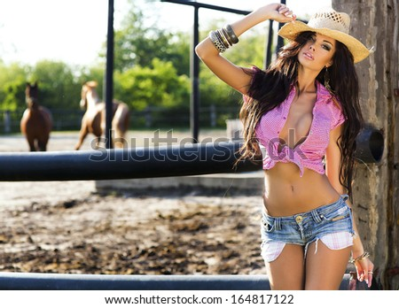 Attractive brunette woman posing wearing sexy clothes, sunny day. - stock photo