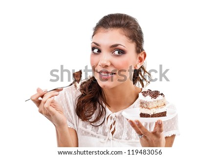Attractive brunette woman with a cake - stock photo