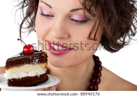 Attractive brunette woman with a cake. Close-up portrait. - stock photo