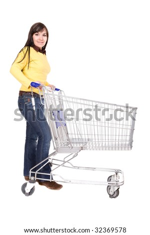 attractive brunette woman with shopping cart - stock photo