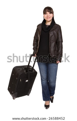 attractive brunette woman with suitcase