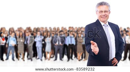 attractive business man with open hand - the elite business team - stock photo