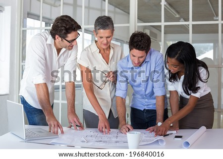 Attractive business people working hard and discussing at a meeting - stock photo
