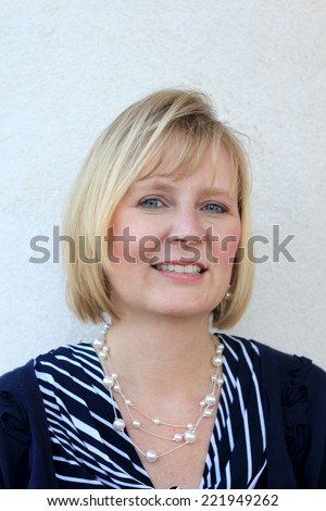 Attractive Business Professional Business Woman Smiling and Happy Baby Boomer Friendly Mom - stock photo