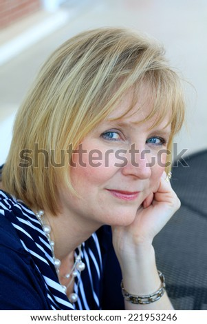 Attractive Business Professional Business Woman Smiling and Looking at the Camera  - stock photo