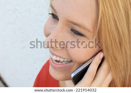 Attractive Business Professional Business Woman Teenager Young on the Phone Blonde Girl College Student  - stock photo