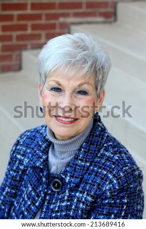 Attractive Business Professional Senior Retired Business Woman Happy  - stock photo