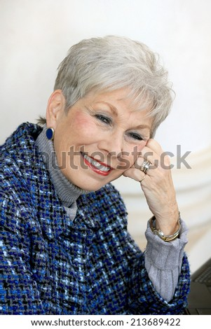 Attractive Business Professional Senior Woman Retired Lady Wearing Blue and Smiling - stock photo