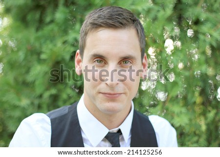 Attractive Business Professional Smiling and Looking at the Camera Wearing a Suit - stock photo