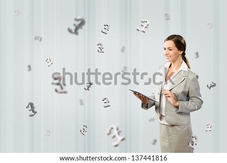 attractive business woman holding a tablet, financial concept - stock photo