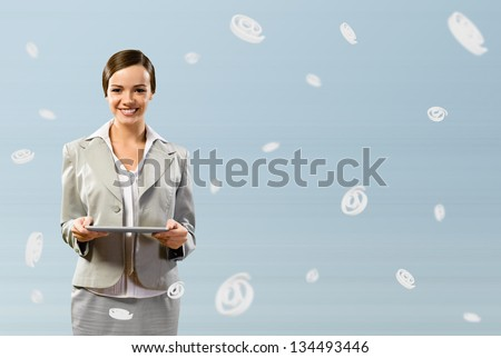 attractive business woman holding a tablet, fly around the signs e-mail - stock photo