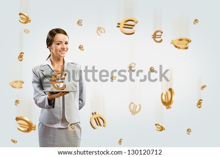 attractive business woman holding a tablet with euro, financial concept - stock photo