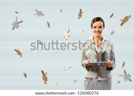 attractive business woman holding a tablet with sign yen, financial concept - stock photo