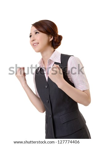 Attractive business woman, low angle shot at studio white background.