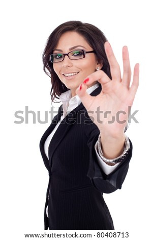 Attractive business woman satisfied with results - ok sign