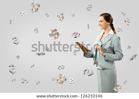 attractive business woman smiling and holding a tablet, concept of business success - stock photo