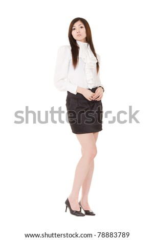Attractive business woman standing and looking at you, full length portrait isolated on white background. - stock photo