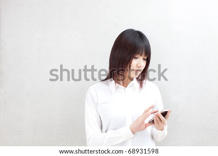 attractive business woman using cellphone - stock photo