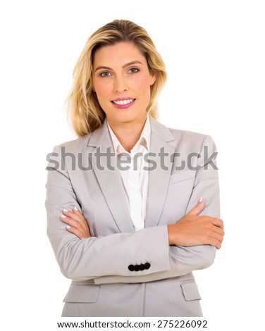 attractive business woman with arms folded - stock photo
