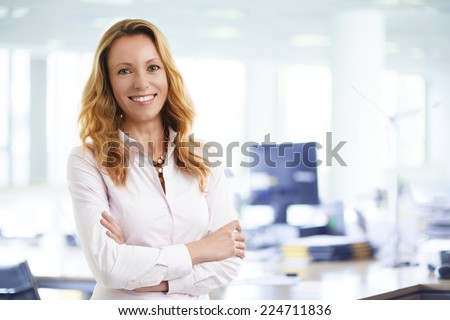 Attractive business woman working on laptop at office. Business people.  - stock photo