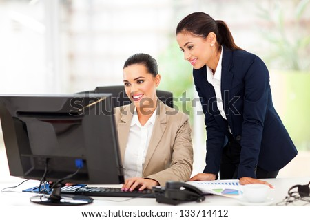 attractive business women working using computer - stock photo