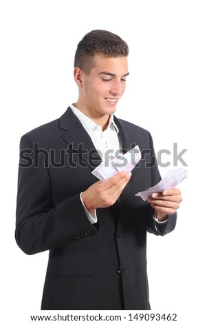 Attractive businessman counting money isolated on a white background