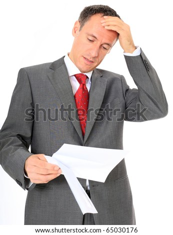 Attractive businessman gets bad news. All on white background - stock photo
