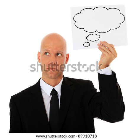 Attractive businessman holding thought bubble next to his head. All on white background. - stock photo