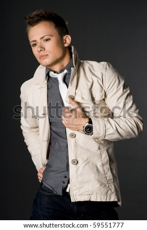 attractive businessman in beige jacket - stock photo