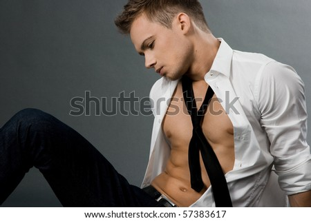 attractive businessman in white shirt - stock photo