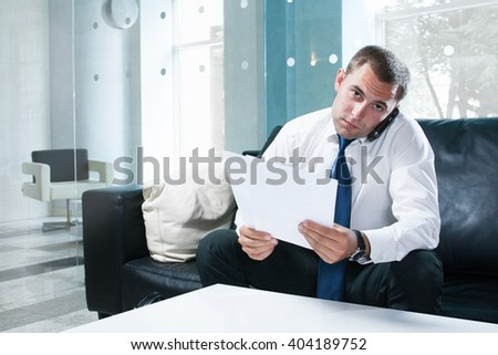 Attractive businessman on phone - stock photo