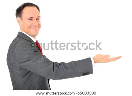 Attractive businessman pointing to the side. All on white background. - stock photo