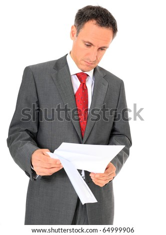 Attractive businessman reading a letter. All on white background. - stock photo