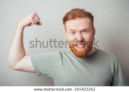 attractive businessman shows some muscles - stock photo