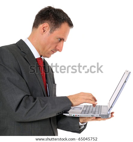 Attractive businessman using notebook computer. All on white background.