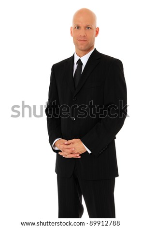 Attractive businessman wearing black suit. All on white background. - stock photo