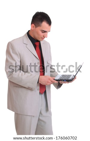 Attractive businessman with a netbook isolated on a white background - stock photo