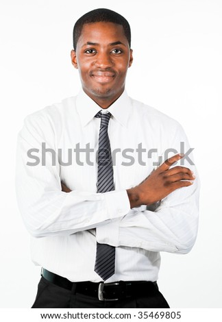 Attractive businessman with crossed arms standing in front of the camera - stock photo