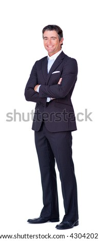 Attractive businessman with folded arms smiling at the camera - stock photo