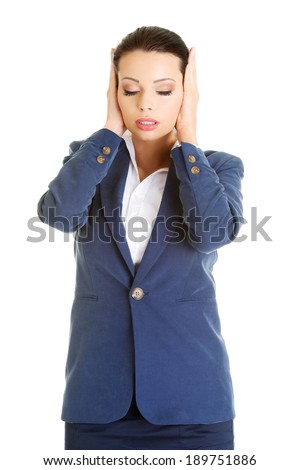Attractive businesswoman covering her ears with hands, isolated on white - stock photo