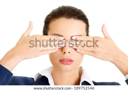 Attractive businesswoman covering her eyes with hands, isolated on white - stock photo