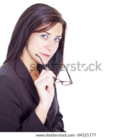 Attractive businesswoman holding glasses on white background - stock photo