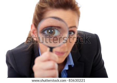 Attractive businesswoman holds magnifying glass, search or spy concept, isolated on white - stock photo
