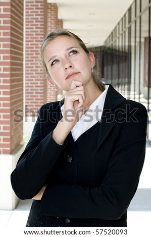 Attractive businesswoman in a thoughtful pose