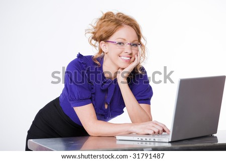 attractive businesswoman in front of a laptop