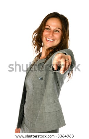Attractive businesswoman in smart suit, smiling and pointing positively to the viewers, isolated on white. - stock photo